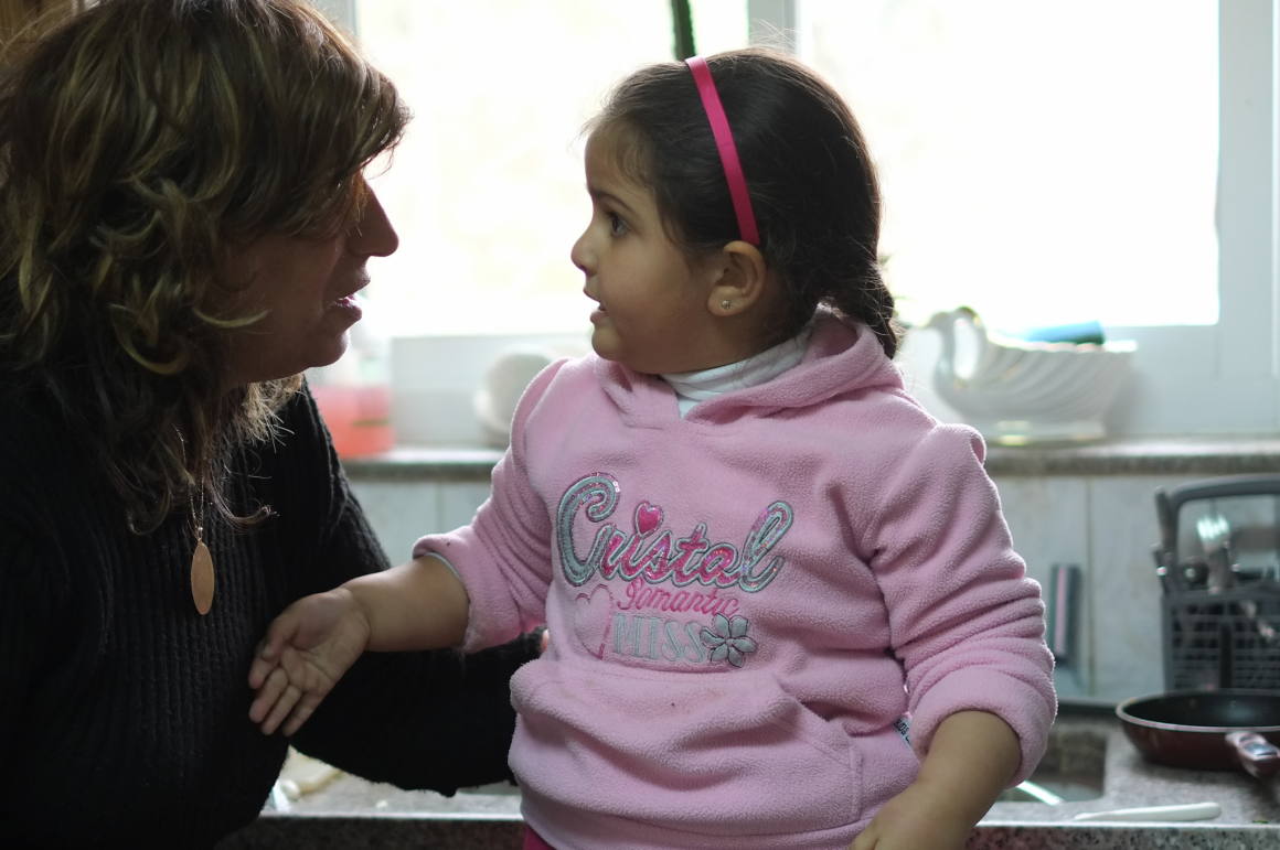 Katreen Sarras and her granddaughter Giselle in her Beit Jala home. Photo: Alex Levac