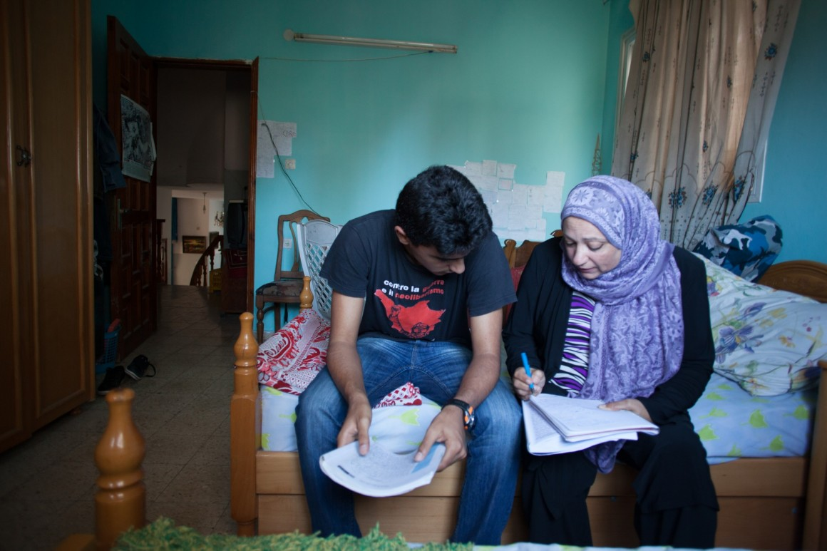 Salwa Yaghi and her son at home in Gaza. Photo: Eman Mohammed